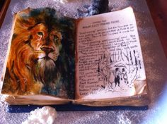 My Narnia birthday cake. I've done the writing with edible ink pen and Aslan us painted with good colouring.