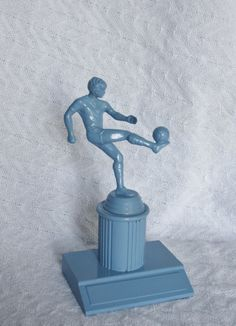 going to try to paint some of Jason's old soccer trophies for our room