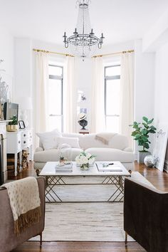 Timeless silhouettes inside this bright white apartment living room! The Everygirl Cofounder Alaina Kaczmarski's Greystone Home Tour | The Everygirl