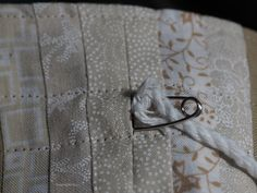 Learn how to make a small, reusable, lined drawstring gift bag. Tutorial by Threading My Way