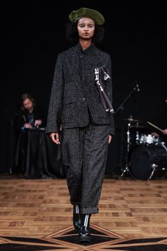 Scandinavian Fashion Weeks AW18: Greatest Hits  JOHANNES ADELE With a black, white and moss green color palette, Adele has brought together influences from the traditional Bolivian sombrero and shawl-draping, Swedish pattern-making, and American 40s and 70s suiting.