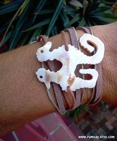 Seahorse carved out of seashell on Brown Faux Suede and by RumCay, $24.95