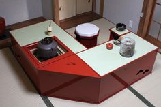 elevated tatami styl table with sunken hearth for winter tea ceremony
