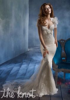 Beautiful lace wedding dress. Great idea for a fall wedding