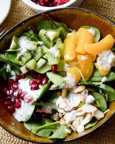 Use kale, pomegranate, orange and kiwi to make this winter salad.
