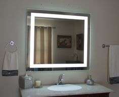Mirrors and Marble™ brand commercial grade wall-mounted rectangular LED bathroom vanity makeup mirror, 40 inches wide, 36 inches tall. Front-Lighted, 6,000 Kelvin white light (sunlight) backlit LED.