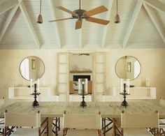 designed by Tom Sheerer. light blue ceiling, directors chairs at the dining room table