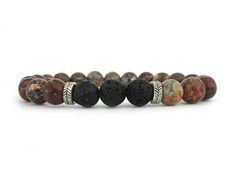 Essential oil bracelet with 8mm Leapordskin jasper beads, 8mm lava rock and metal accent beads. Diffuser bracelets are a wonderful way to wear your essential oils. Simply rub a drop of your favorite essential oil directly on the lava rock beads and enjoy the benefits of your oils all day long. The scent will diffuse for 1-2 days depending on the particular oil you select. Some oils can be stronger than others and such may last a little longer. Natural lava rock beads include naturally-formed…