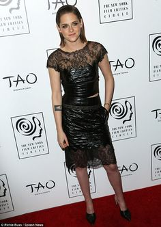 Stand-out star: Kristen looked chic in a leather-look quilted two-piece dress with lace tr...