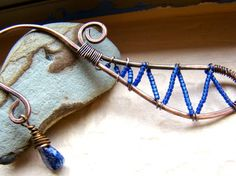 Copper metalwork bookmark with wire wrapped blue glass seed beads $18