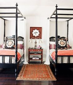British Colonial style with beds that are simplied version of West Indies design but colors that feel African & there's that mirror & its Moorish design.