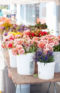 Take a trip to your downtown flower mart and gather up some blooms for a once a week farmers market night. Fun start up, start small so you don't overbuy until you see the sales potential to buy more. Easy set up in buckets, galvanized pots and can use crates to create flower display heights. {www.artisansbloom.com}