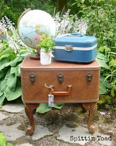 find a thin and slim suitcase, remove the lid, put a cushion inside and leather bands across to be buckled in with the suitcase. Install low vintage legs