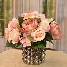 A beautifully hand crafted designer bouquet created of soft rose colors.  Created with roses, hydrangeas and peonies set in a contemporary style Dark Silver Vase.  Great  idea for gifts.  Perfect size for RVs, , side tables and baths. 11'' H x 11'' W x 10'' D