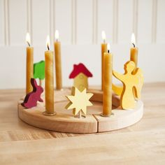 Wooden Waldorf Birthday Ring. i like the idea of the ring, which can also be used for advent. i'm not into these particular figures.