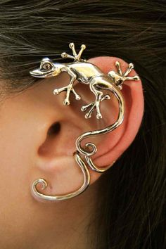 This antique bronze Curious Gecko Ear Wrap, perches playfully atop the ear, tail flowing along the downward curve of the ear. Configured for the left ear only, it fits securely, with an added twist to it's tail that cuffs the edge of the ear. -From Etsy
