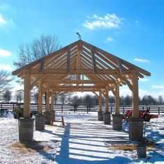 """Stunning timber frame pavilion with the whetting branch tacked at the top. This age-old """"topping off"""" tradition is still practiced by Homestead Timber Frames.  Timber Frame Pergola- Homestead Timber Frames- Crossville Tennessee"""