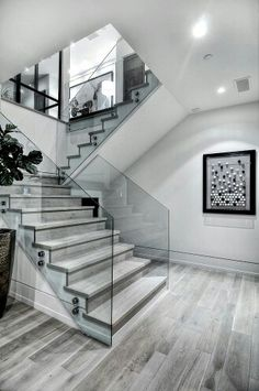 Modern staircases can take a room from nice to wow! Whether it's an older home with a large grand staircase or a modern home with a staircase that