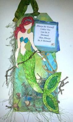 Mermaid Tag by Tami Moritz. Using Julie Nutting doll stamp. Tim Holtz ink stains. Cricut anchor. Plus other neat items around. Came out kinda cool.