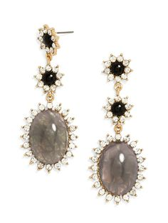Crystal plays off the chic dove-gray hue of these unexpected statement earrings. Adorable onyx flowers add a hint of femininity.