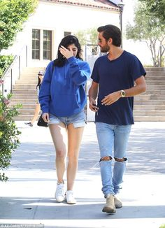 Co-ordinated: Most people don't try to dress to match their car, but Kylie and Scott had chosen their hue to key in with the aqua Ferrari which was their ride