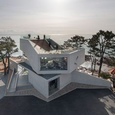 This coastal cafe in the South Korean city of Gijang comprises a series of enormous concrete volumes that dwarf neighbouring houses