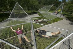 Dymaxion Sleep (curled up)is a structure of nets suspended above a field of aromatic plants. The original structure, installed in 2009, was...