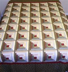 The attention to color placement allows these Log Cabin quilt blocks to appear three dimentional because of the placement of the light and dark strips creating a shadow effect. This is excellent designing.