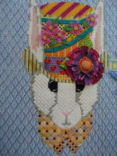 Incredible stitches in this needlepoint rabbit