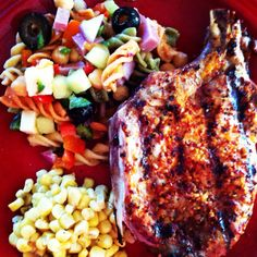 Grilled bourbon spiced pork, loaded pasta veggie salad and sweet white corn