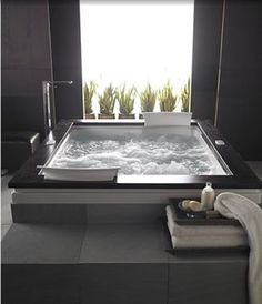 jacuzzi tubs are necessary! and i absolutely love the modern style of this.