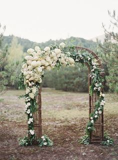 This arch is gorgeous. The flowers are overwhelmingly beautiful. ~A