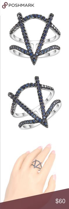 Unique Rodium plated navy CZ adorned ring Unique Rodium plated navy CZ adorned ring, size 7. Jewelry Rings