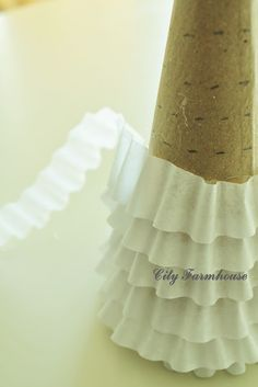 coffee filter cone tree - wonder how adding glitter to some of the layers would look