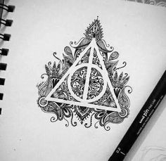 Gorgeous version of the Deathly Hallows symbol. This would be super cool as a tattoo.