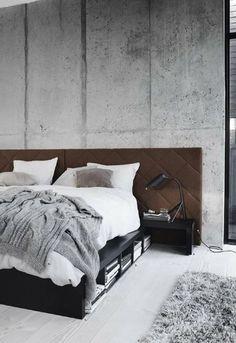 Pared de cemento en dormitorio industrial | Pensata