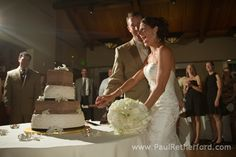image of wedding cake cutting oak pointe country club wedding