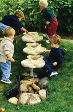 What a lovely way to do a water feature that's fun and safe for little kids...