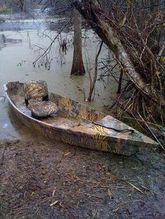 wooden gator boat. I like it.