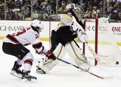 Penguins goaltender Marc-Andre Fleury clears the puck away from the Devils' Bobby Farnham in the second period Tuesday, Jan. 26, 2016, at Consol Energy Center. — Chaz Palla | Tribune-Review
