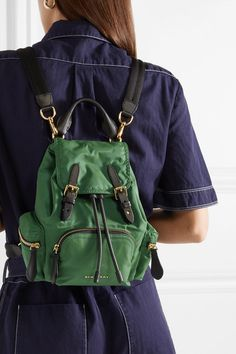 Green gabardine, black leather Snap-fastening front flap, drawstring top Designer color: Racing Green Comes with dust bag Weighs approximately Imported Burberry, Baskets, Leigh Miller, Small Backpack, Jumpsuit, Backpacks, Leather, How To Wear, Bags