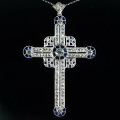 An amazing quality Art Deco cross pendant loaded with sapphires and diamonds in platinum, original box, circa 1920's, excellent vintage condition… A touch of history.