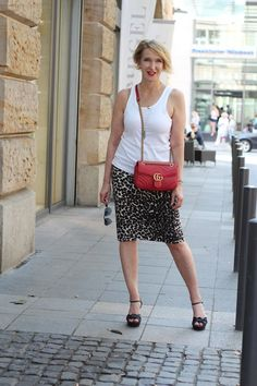 A fashion blog for women over 40 and mature women Top: Aldi Skirt: Norma Kamali Sandals: What for Bag: Gucci
