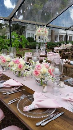 Soft pink roses add a pop of color to these white floral centerpieces we designed for this Cypress Grove Estate House wedding.