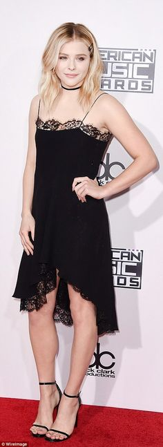 LBD lady! Chloe Grace Moretz teamed her lace trimmed dress with ankle-strap stilettos...