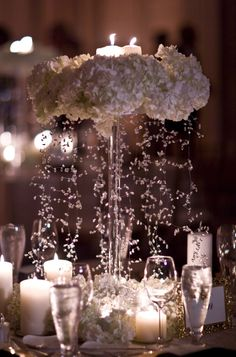Love this centerpiece....would be great for a spring wedding. Looks like rain coming from the flowers which resemble clouds.