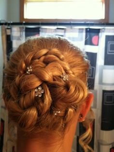 Just did Paige's hair for 8th grade promotion...called a flower braided bun!