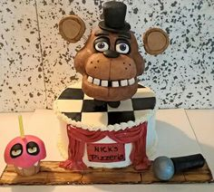 Totally edible five nights at Freddy cake with rice crispy treat cupcake and microphone #fivenightsatfreddys #freddyfazbear