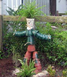 Recycle your garden pots to make a pot person, like the scarecrow shown here