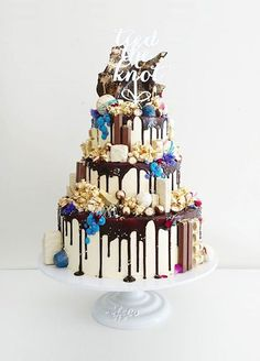 17 Unique Wedding Cake Ideas: How fun is this cake, dripping with chocolate and overflowing with embellishments? Cake by Unbirthday Bakery